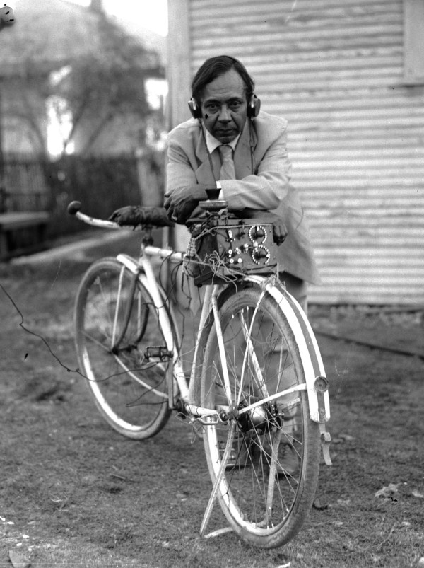 Leo Menchaca wearing earphones attached to a radio that he installed on his bicycle, San Antonio, 1929.  (San Antonio Light Photograph Collection MS 359: L-1202-C)