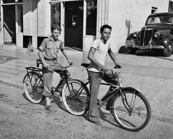 Because of the World War II rubber shortage, Eugene Bouse (left) and Leslie Maly have combined their bicycles for the duration of the war, San Antonio, June 1942.  (San Antonio Light Photograph Collection MS 359: L-2972-A)