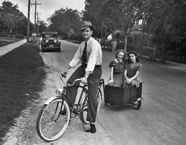 Charles Merritt gives friends Mary Catherine Grimes (left) and Doris Burnham a ride in the trailer he built for his bicycle, San Antonio, June 1942.  (San Antonio Light Photograph Collection MS 359: L-2976-A)