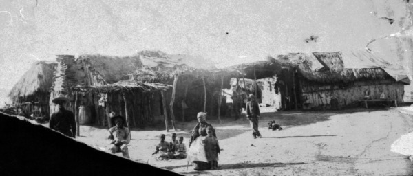 -- Sampson and Mary July and children outside their house, constructed of local material, in Black-Seminole village near Brackettville, Uvalde County, circa 1905.  (MS 362:  068-1099)
