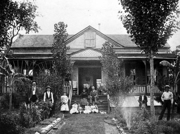 Czech-Texans Ignatz and Theresa Gallia and family pose in their yard planted with bananas and other imported plants, Engle, Fayette County, circa 1896.  (MS 362: 078-0281)