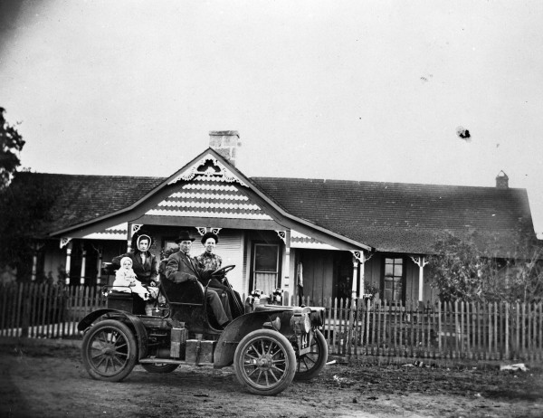 Dr. O.C. Jackson shows off his automobile parked in front of the family home, Voca, McCullough County, circa 1909.  (MS 362: 078-0488)
