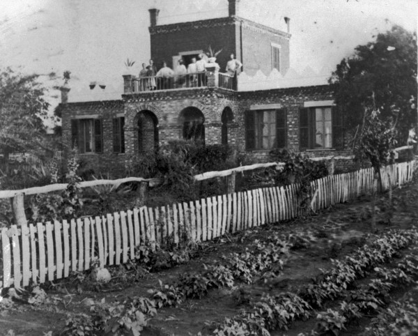 French-Texan Gustave Toudouze's house, constructed of brick from the owner's private brickyard, Losoya, Bexar County, circa 1880s. (MS 362: 078-0533)