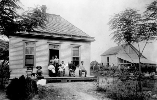 Japanese-Texans Rihei  and Hisa Onishi with family and friends outside their newly purchased house and rice farm near Webster, Harris County, 1904.  (MS 362: 086-0263)