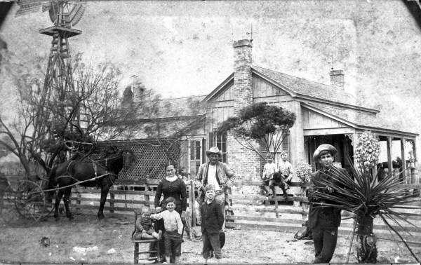 Louisa Jane and Grey White and children stand outside their ranch house of box and strip construction in northwestern Dimmitt County, circa 1886.  (MS 362: 088-0082)