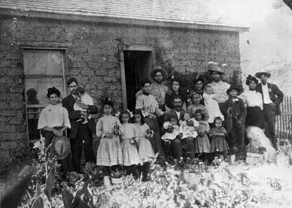 Family gathering outside the adobe house of Susie and Ben Gallego, Alpine, Brewster County, 1908.  (MS362: 096-1042)