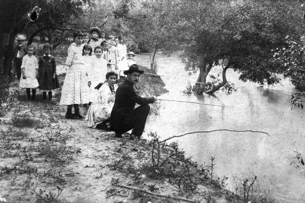 Children watch adults fish during an outing at the Nueces River, circa 1890.  Photograph by I. N. Hall, itinerant photographer based in Cotulla.   (General Photograph Collection, MS 362:  088-0293)