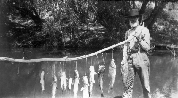 Joe Redwine poses with his catch, Comanche County, 1910s.  (General Photograph Collection, MS 362:  098-0814)