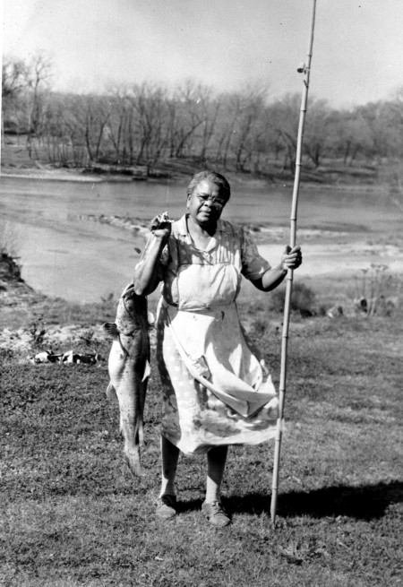 Nora Washington with catfish she caught in the Colorado River, Bastrop, 1950s.  Photograph by Bob Standifer.  (General Photograph Collection, MS 362:  102-0218)