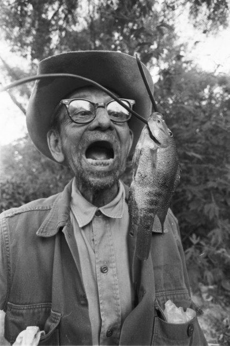 Raymond Ramirez with perch that he caught in the San Antonio River near River Road and Mulberry Avenue, San Antonio, 1984.  (San Antonio Express-News Collection, MS 360:  E-0256-126-06)