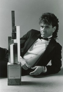 Larry Broom with Addie award presented for his design of the Forum logo, March/April 1986 Forum, photograph by Reuben Njaa