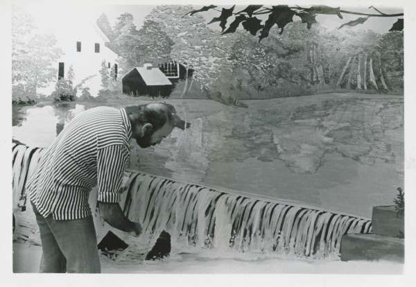 John Shown working on stitchery mural for Bexar County Hospital blood bank, undated