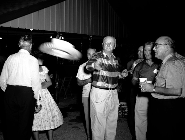 Otto Koehler, Pearl's chairman of the board and president, tosses his hat, 1958.  (MS 355: Z-1807-B-24)