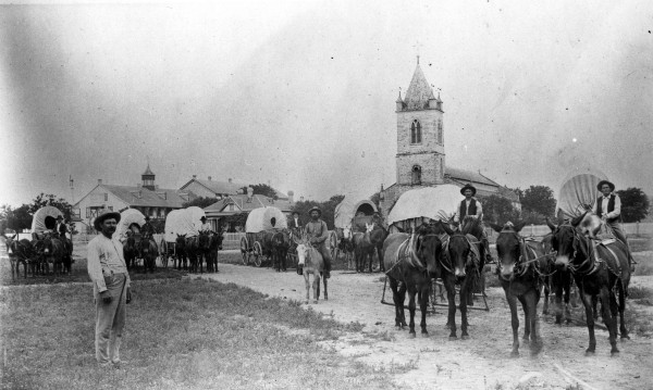Wagon train pauses on Houston Square, circa 1900.   (MS 362:  096-0537)