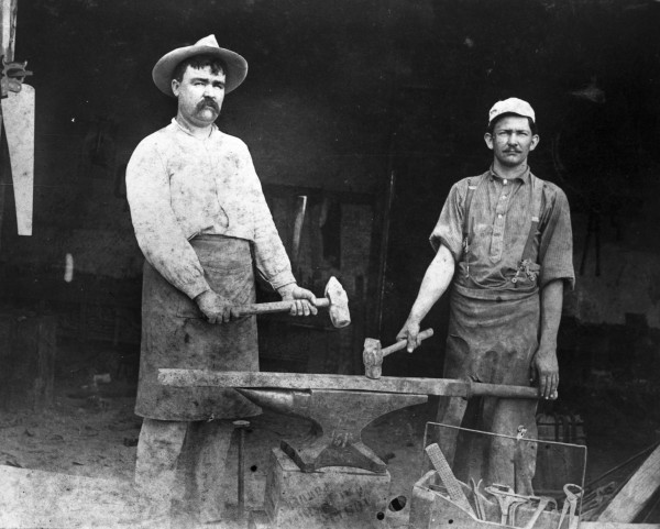 Ed Tschirhart (left) and Andy Halberdier, Tschirhart Blacksmith Shop, Paris Street (Houston Square), ca. 1905.  (MS 362: 96-542).