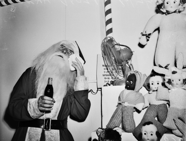 Santa Claus (Floyd Arnold) takes a break from his job in a department store, 1948.  (MS 359: L-3681-C)