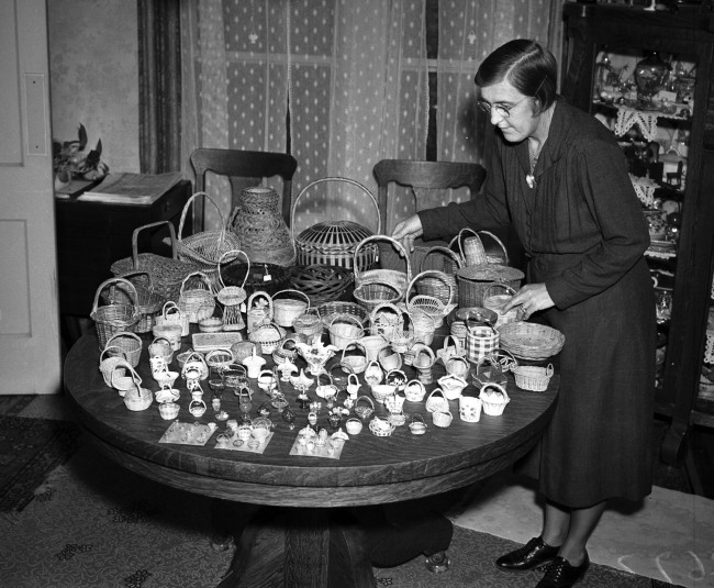 Mrs. Sam Fields with baskets made of various materials and from countries around the world, February 1941.  (MS 359:  L-2672-J)