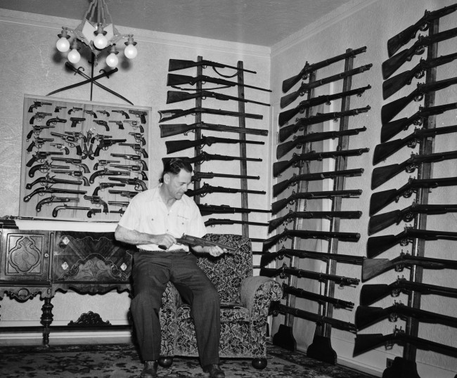 "Bob Grimsinger in his ""home arsenal"" with guns he began collecting after inheriting an antique one, July 1941."