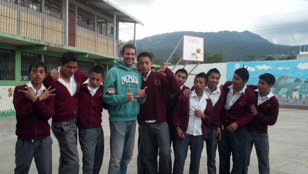Will is located in the center with the Maui sweatshirt. He is pictured with his students from the Escuela Oficial Rural Mixta in Quetzaltenango, Guatemala. He volunteered at the school to teach the basics of the English language.