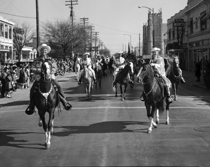 "Gene Autry and Gail Davis ""Annie Oakley"" lead the western parade that officially opens the Stock Show and Rodeo, February 7, 1958.  (MS 355:  Z-2484-A-03)"