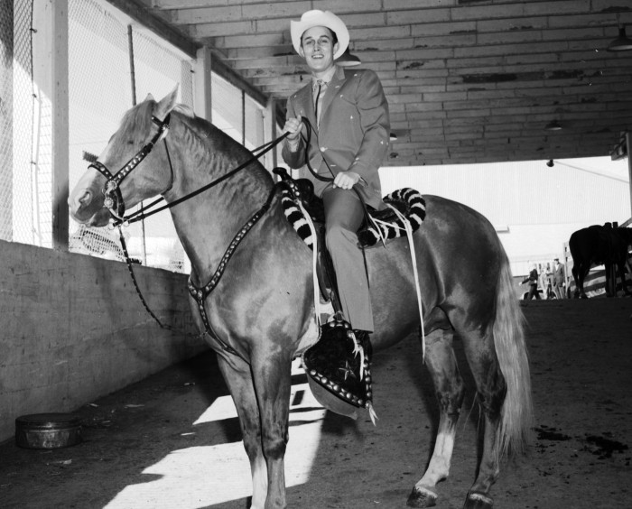 "Jimmy Dean ""Mr. Country Music"" prepares to ride into the rodeo area, where he will dismount and sing to the crowd, 1960.  (MS 355:  Z-2490-C-01)"