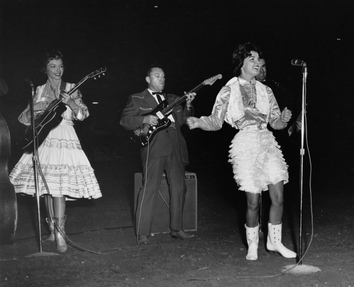 Anita Bryant, America's top female vocalist at the time, performs during her first rodeo entertainment performance, February 1962.  (MS 355:  Z-2495-B-28510)