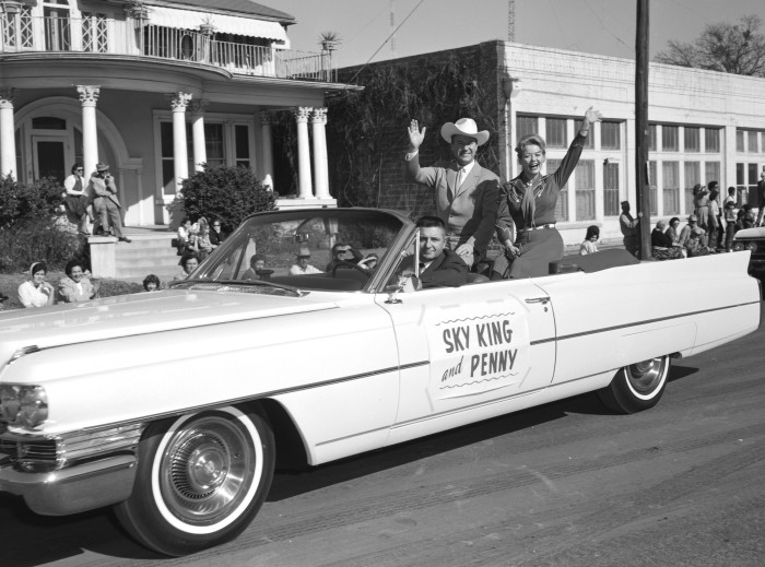 "Rodeo song-and-dance team performers Kirby Grant, television's flying cowboy ""Sky King,"" and Gloria Winters ""Penny King,"" ride in the western parade, February 8, 1963.  (MS 355:  Z-2499-A-R66)"
