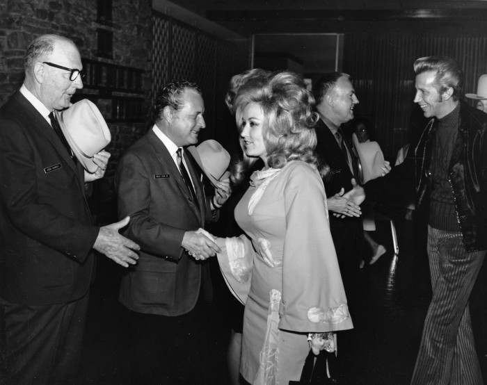 Dolly Parton and Porter Wagoner arrive at a welcoming reception, February 1970.  (MS 355:  Z-2521-C-592)