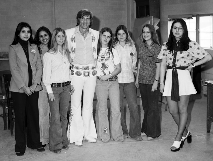 Singer and actor John Davidson poses with fans, February 1974.  (MS 355:  Z-2545-C-01)