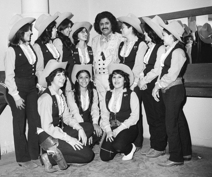 Freddy Fender poses with fans, February 1979.  (MS 355:  Z-2561-C-02-8)