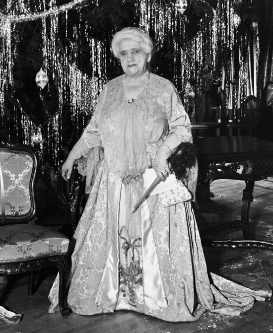 Anna Goodman Hertzberg poses at her annual Christmas party for members of the Tuesday Musical Club, December 1933.  Hertzberg (1862-1937), a pianist trained at the New York Conservatory of Music, founded the Tuesday Musical Club as an all-women's chamber music society.  The Tuesday Musical Club Records are housed in UTSA Special Collections, Main Campus:  http://www.lib.utexas.edu/taro/utsa/00225/utsa-00225.html