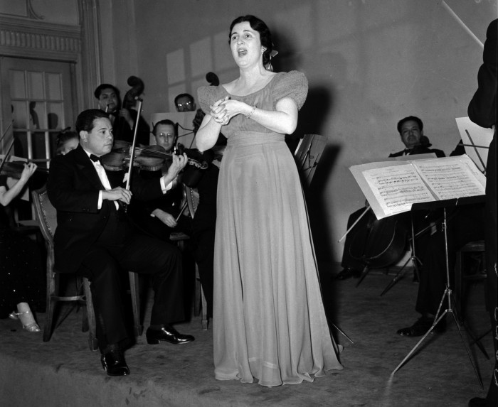 "Lois Farnsworth Kirkpatrick (Hull) sings during performance of the String Players in the ballroom of the St. Anthony Hotel, March 1939.  (MS 359:  L-2073-C).  Hull (1926-2014), later a resident of Canyon, Texas, acted and sang for many years in the musical drama ""Texas."""