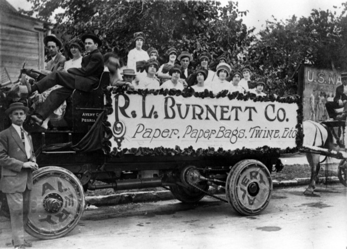 Group in an Avery truck advertising the R. L. Burnett Company, ca. 1915.  (General Photograph Collection, MS 362:  069-8513)