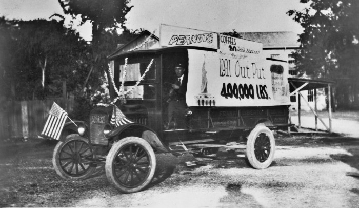 Frank Liberto Wholesale Grocers advertising the company's roosting of coffee and peanuts, ca. 1922.  (General Photograph Collection, MS 362:  077-0145)
