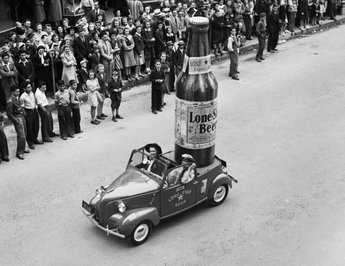 Lone Star Brewing Company entry, a giant bottle of Lone Star in a Crosley convertible, (San Antonio Light Photograph Collection, MS 359:  L-2738-R)