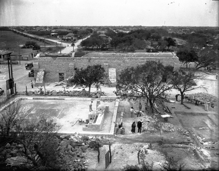 View looking west from church roof showing large model of the mission complex that was used for planning the reconstruction.  Beyond is the granary, with new roof partly complete, April 1933. (MS 359:  L-1424-J)