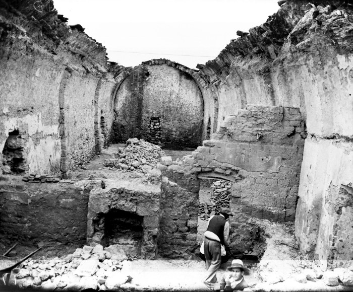 Workers remove debris inside the Mission San Jose granary, owned by the San Antonio Conservation Society, early December 1932.  The east wall (left) was determined to be unstable and demolished.  (MS 359:  L-0175-K)