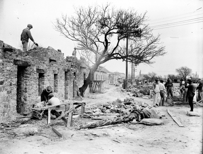 The following year, the San Antonio Light photographer stood in the same location to record the reconstruction of the Indian apartments, using sandstone as the building material, February 1934.