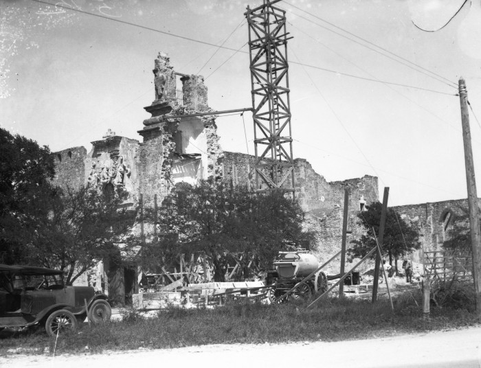 A massive frame scaffold sits beside the church during reconstruction of the tower by Frederick Schutte Construction Company, April 1928.  The project was finished by the middle of August, with Schutte announcing that the work was accomplished using only the original stones.  (MS 359: L-0512-