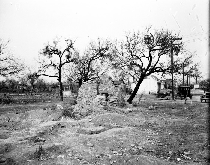 Remnants of the original Indian living quarters, constructed of tufa, along the west wall of the mission compound, January 1933.  (MS 359:  L-1424-G)