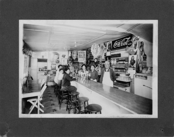 De la Rosa Café, shortly before it was sold to Jovita's brother-in-law, circa 1946.  Jovita Ortiz is behind the counter next to her parents.   (MS 454:  115-163)