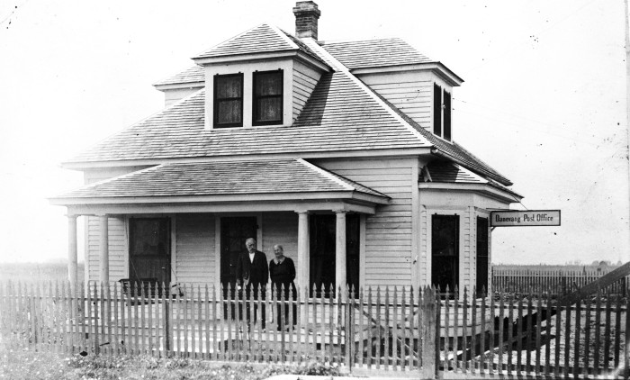 Postmaster Herman P. Hermansen and wife stand on porch of their home and post office in the Danish farming community of Danevang, Wharton County, circa 1905.  (General Photograph Collection, MS 362:  098-0550)