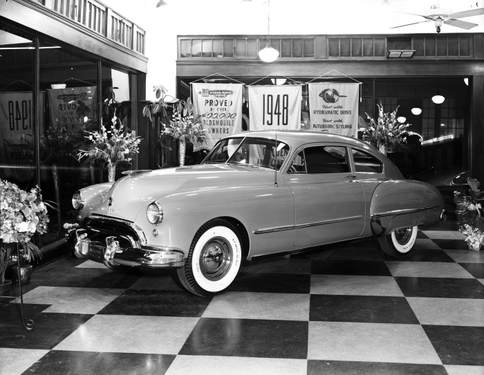 The 1948 Oldsmobile 98 Futuramic Club Sedan, with hydramatic drive, on display at General Oldsmobile Company, 801 Broadway. (Zintgraff Studio Collection, MS 355: Z-0910-A-11)