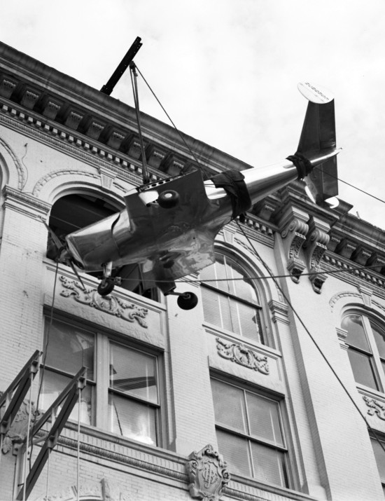 An Ercoupe, advertised as the first spinproof private airplane, is hoisted from Commerce Street to the fourth floor of Joske's Department Store, December 1945. (Zintgraff Studio Collection, MS 355, Z-1284-A-02)