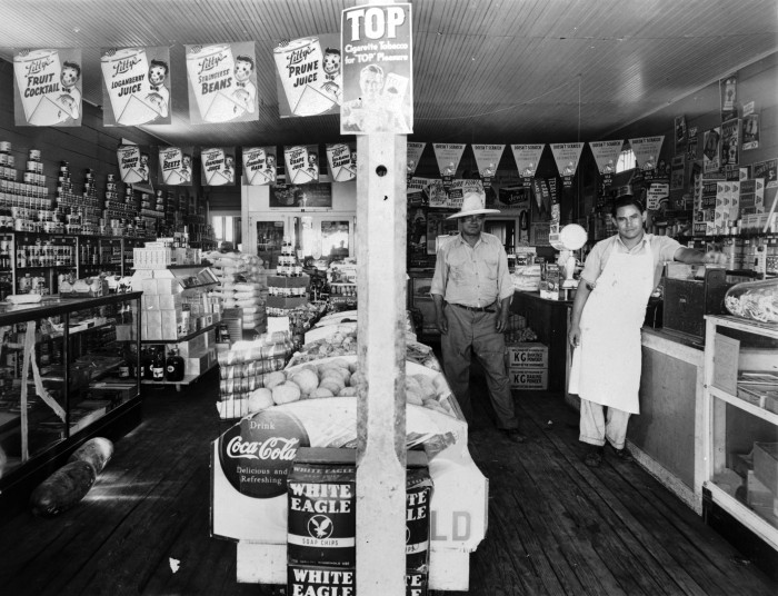 Tomas Valadez (left) and Lito Valadez in their grocery store at corner of South Fifth and West Murphy Streets, Alpine, 1940. . (General Photograph Collection, MS 362: 096-1036, courtesy of B. J. Gallego)
