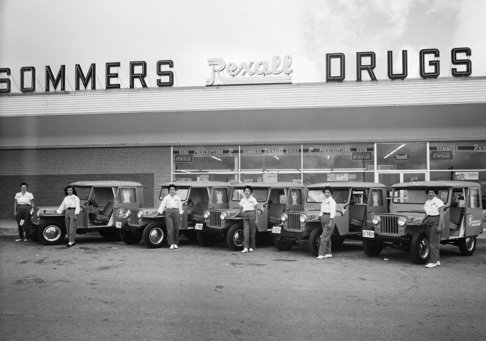 Employees beside delivery jeeps outside Sommers Drug Store No. 29, 1021 Rittiman Road, San Antonio, 1959. (Zintgraff Studio Photograph Collection, MS 355: Z-2340-C-15794)