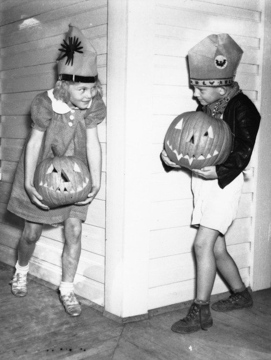 Betty Ann Lowery and Donnie York holding jack-o'-lanterns, October 1938. (San Antonio Light Collection, MS 359: L-1980-M)