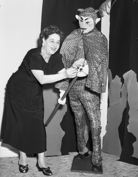 Mabel Johnson, wife of Dr. Ted Johnson, adjusts one of the life-size characters she created for a Halloween party in her home, 1952. (San Antonio Light Collection, MS 359: L-4407-D)