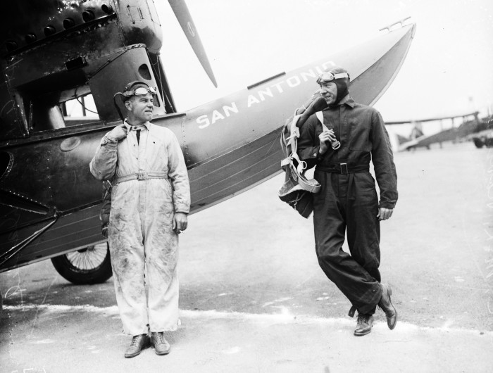 "San Antonio native Captain Arthur B. McDaniel (left), second in command of the flight, and Lt. Charles McK. Robinson stand beside their plane, December 1926. Thousands of local residents welcomed their return to Kelly Field in the ""San Antonio"" on May 11, 1927. (MS 359: L-0672-D)"