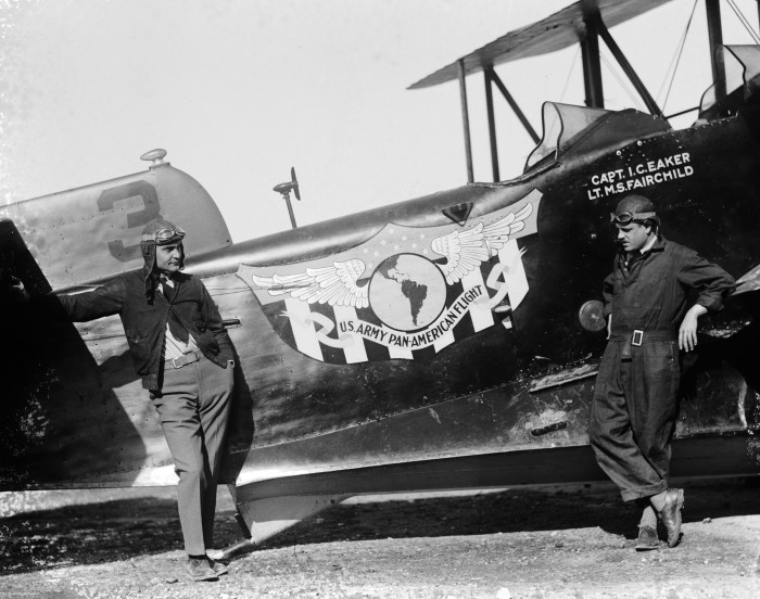 "Pilots of the ""San Francisco"" Capt. Ira C. Eaker (left) and Lt. Muir S. Fairchild stand beside the flight insignia, designed by Duncan Field employee B. F. Ginther, December 1926. The ""San Francisco,"" the"